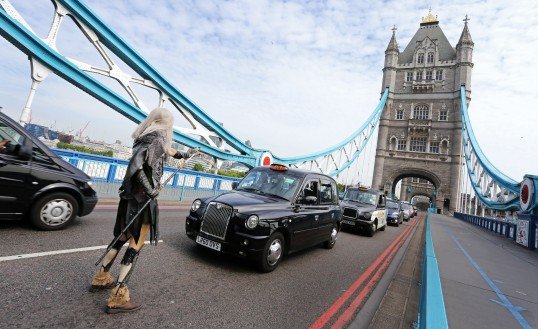 A Whitewalker stops traffic over London Bridge to celebrate the release of Game of Thrones Season 5 on Digital HD